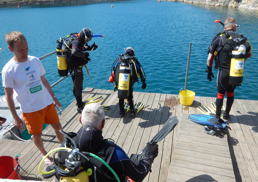 Easy Divers Getting Ready to Enter the Water