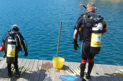 Divers preparing to go in the water East Divers